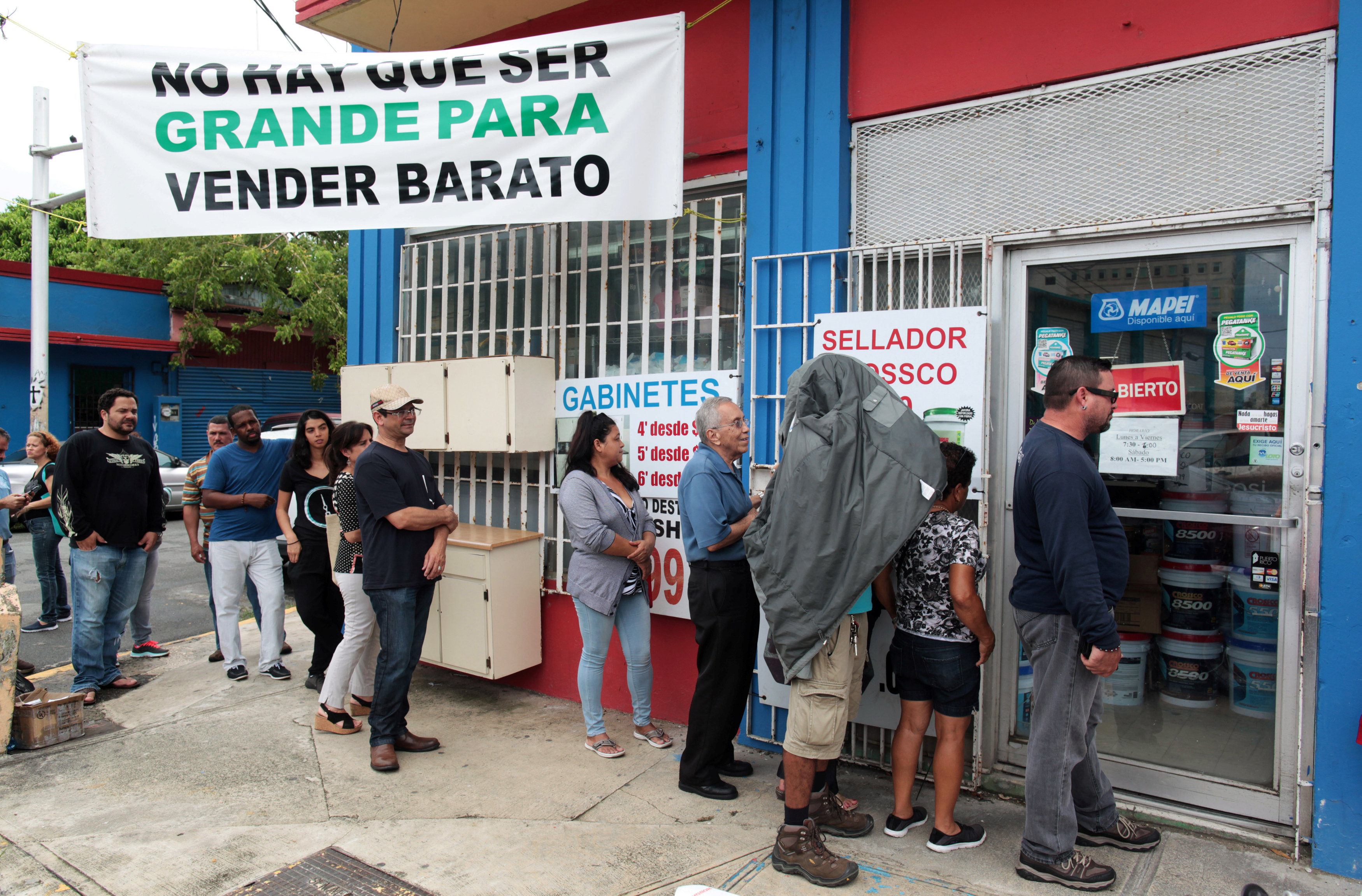 People stand in line outside a hardware store as they prepare for Hurricane Irma, in Bayamon, Puerto Rico on Sept. 5, 2017. (REUTERS/Alvin Baez)