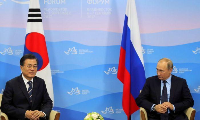Russian President Vladimir Putin and his South Korean counterpart Moon Jae-in attend a meeting during the Eastern Economic Forum in Vladivostok, Russia on Sept. 6, 2017. (Sputnik/Mikhail Klimentyev/Kremlin via REUTERS)
