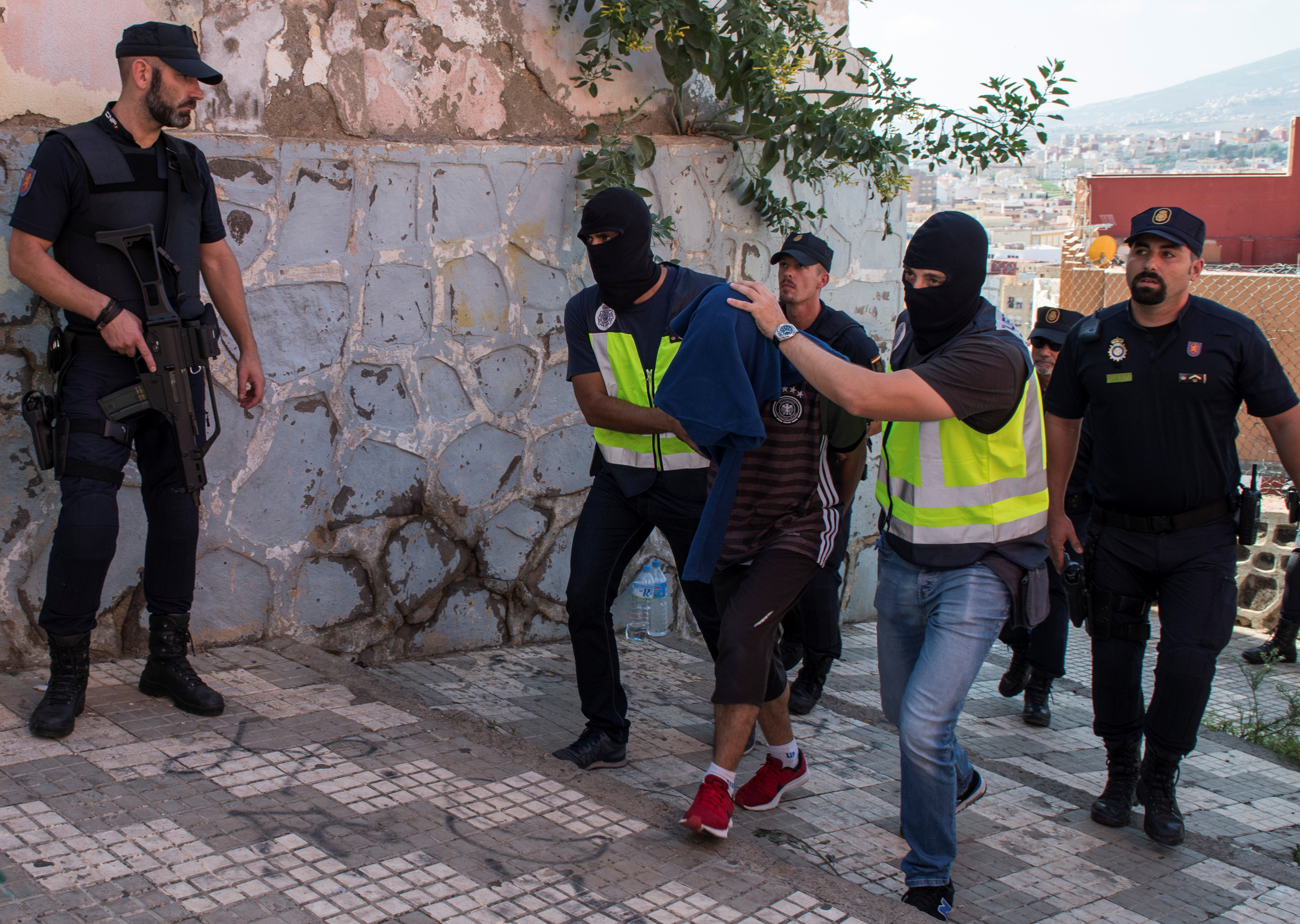 Spanish police arrest a man suspected of belonging to an Islamist militant cell that simulated decapitations in the Spanish north African enclave of Melilla on Sept. 6, 2017.  (REUTERS/Jesus Blasco de Avellaneda)