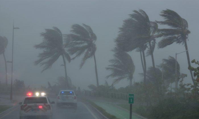Police patrol the area as Hurricane Irma makes landfall in San Juan, Puerto Rico. (REUTERS/Alvin Baez)