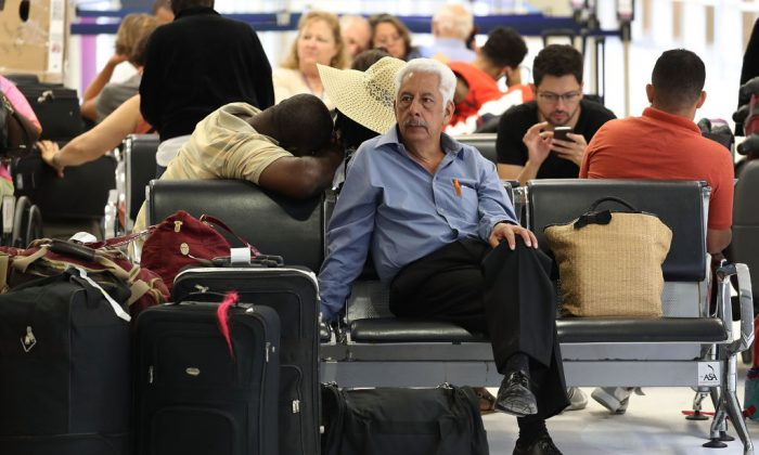Jose Milton waits at the Fort Lauderdale-Hollywood International Airport on May 9, 2017 in Fort Lauderdale, Florida.   (Joe Raedle/Getty Images)