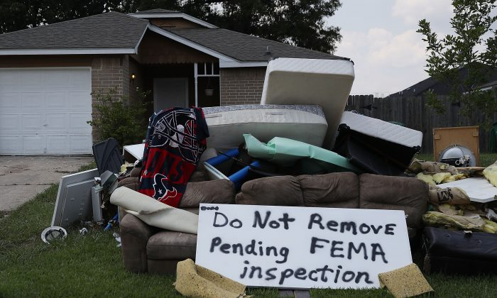 "A sign reading ""Do Not Remove Pending FEMA inspection"" is seen with water logged items in front of a home after Hurricane and Tropical Storm Harvey on Sept. 2, 2017 in Houston, Texas. (Joe Raedle/Getty Images)"