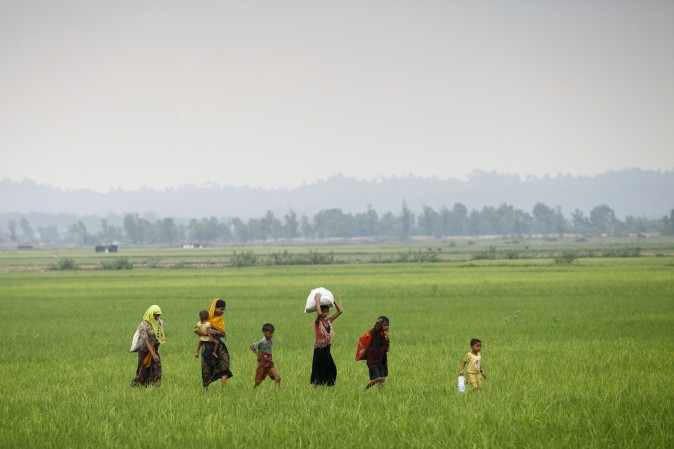 Rohingya refugees from Burma's Rakhine state arrive near the border of the Bangladeshi town of Teknaf on Sept. 5, 2017. Nearly 125,000 refugees have entered Bangladesh since a fresh upsurge of violence in Burma on August 25. (K M ASAD/AFP/Getty Images)