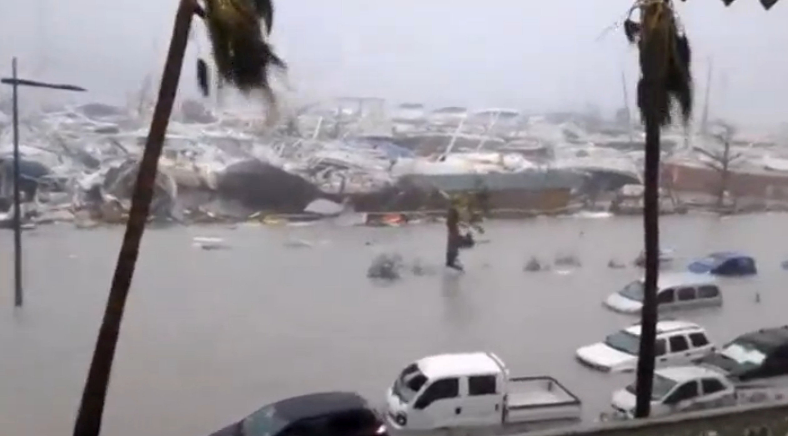 General view of half-submerged vehicles, boats and debris in the flooded harbour as Hurricane Irma  hits the French island territory of Saint Martin September 6, 2017. (RCI GUADELOUPE/Handout via REUTERS)