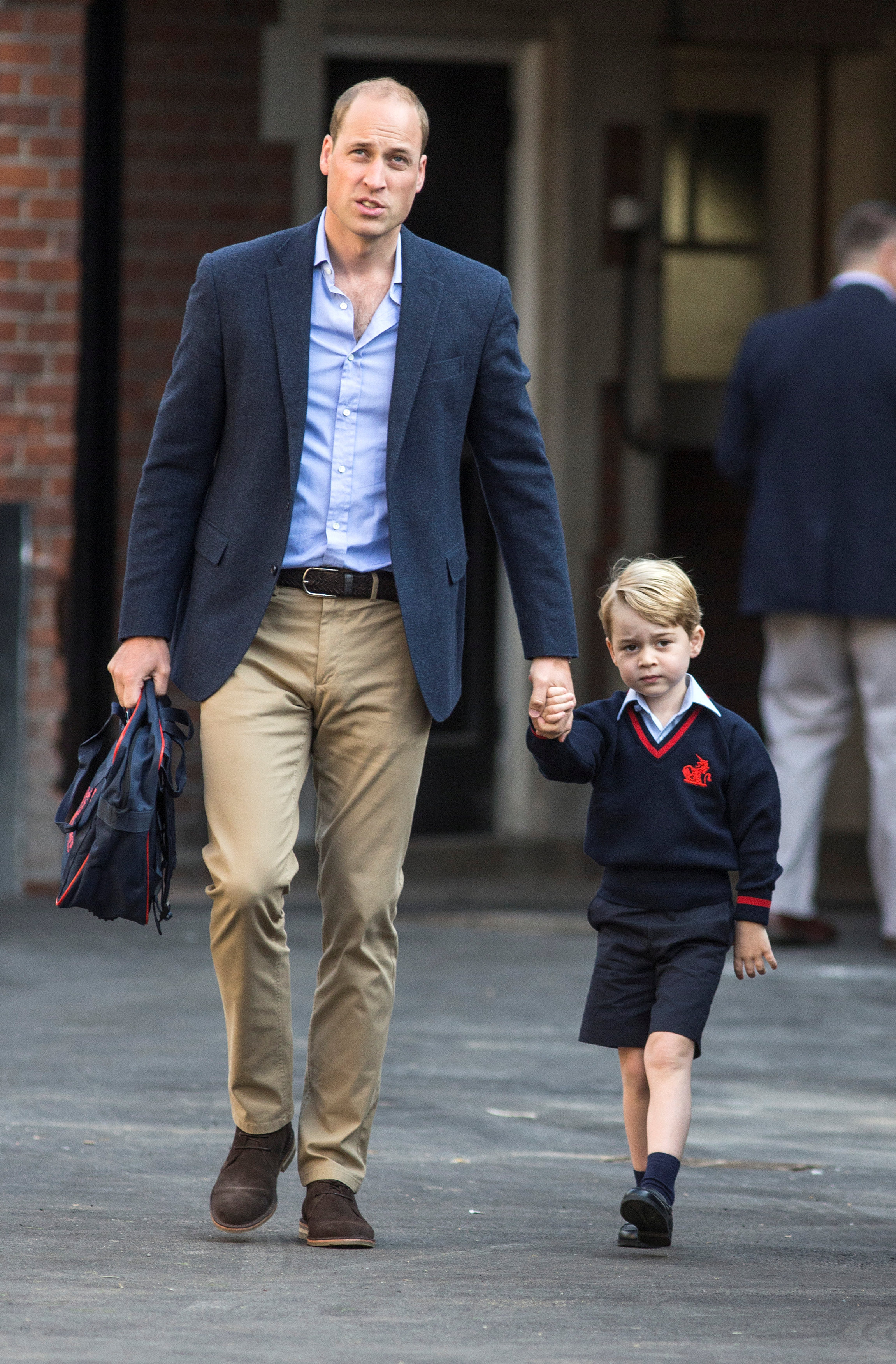 Britain's Prince William accompanies his son Prince George on his first day of school at Thomas's school in Battersea, London, Sept. 7, 2017. (REUTERS/Richard Pohle/Pool)