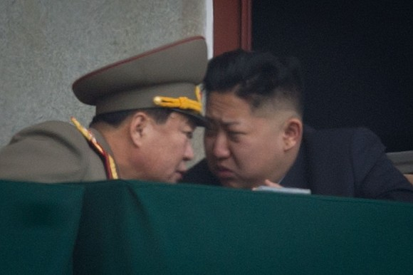 North Korean leader Kim Jong-Un (R) talks to a military aide during an official ceremony at the Kim Il-Sung stadium in Pyongyang on April 14, 2012. (Ed Jones/AFP/Getty Images)