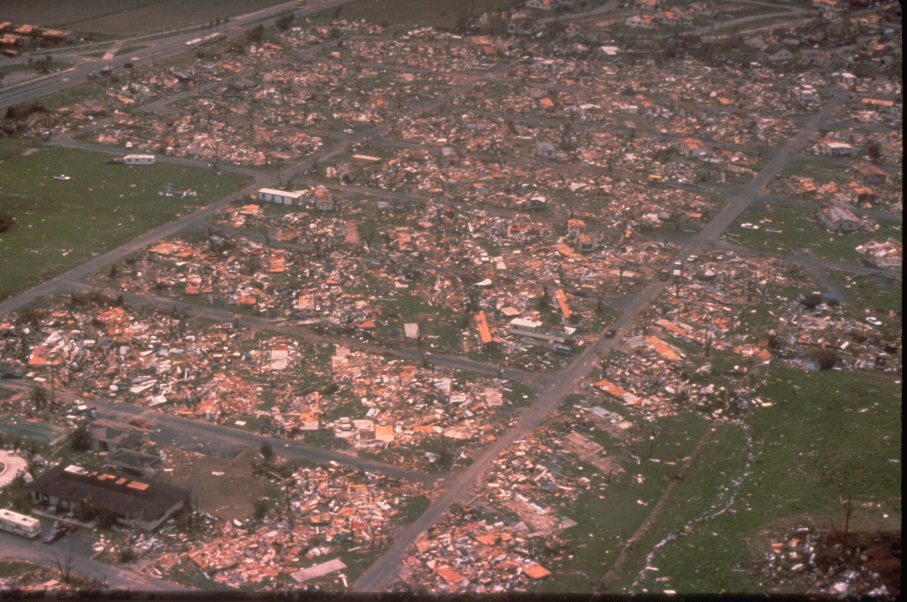 An aerial view of Dade County, Florida, shows the damage Hurricane Andrew wrought on a mobile home park when it struck in a large mobile home park in mid August, 1992. One million people were evacuated and 54 died in the hurricane. (Bob Epstein/FEMA News Photo/via Wikimedia Commons)