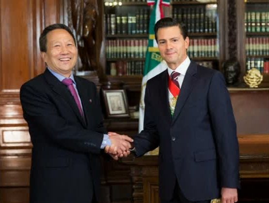 Mexican President Enrique Pena Nieto with North Korean ambassador Kim Hyong Gil (Mexican Presidency Handout)