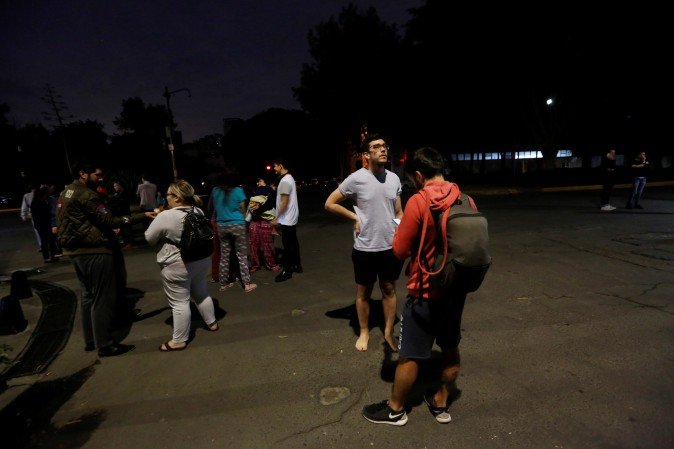 People gather on a street after an earthquake hit Mexico City, Mexico late Sept. 7, 2017. (REUTERS/Claudia Daut)