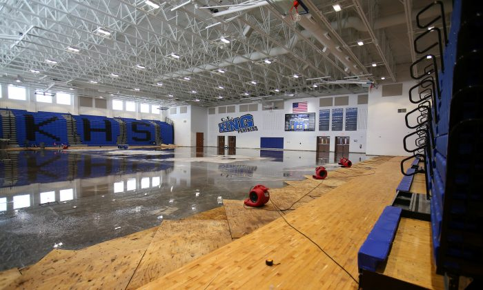 After removing the wood flooring flood waters remain inside the gymnasium at C.E. King High School following the aftermath of tropical storm Harvey in Houston, Texas on Sept.  8,  2017. (REUTERS/Mike Blake)