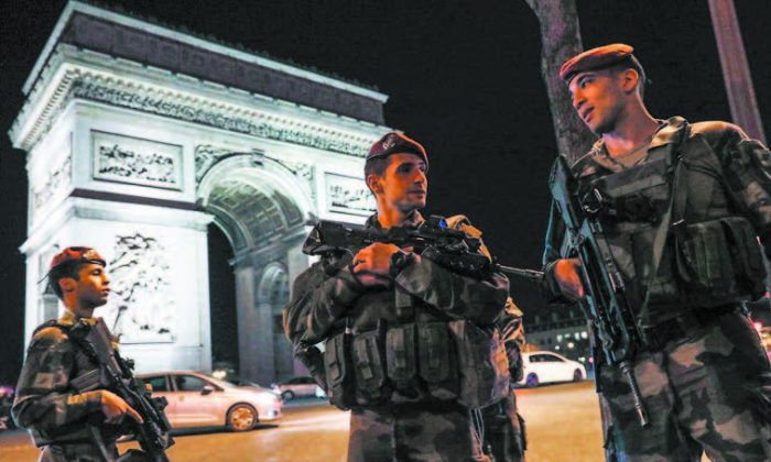 French soldiers stand guard at the Arc de Triomphe near the Champs Elysées in Paris after a shooting on April 20. (THOMAS SAMSON/AFP/GETTY IMAGES)