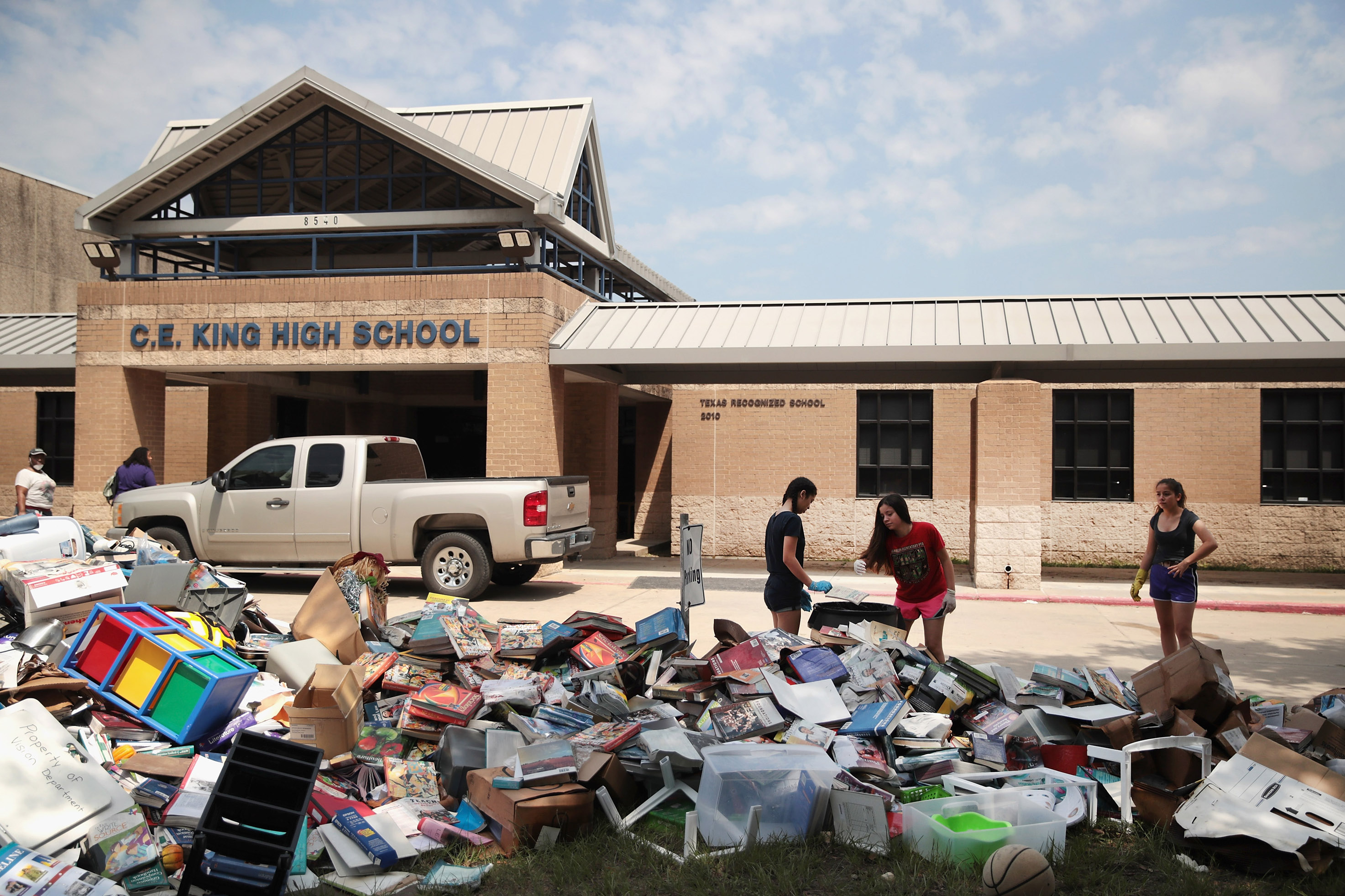 Volunteers and students from C.E. King High School help to clean up the school after torrential rains caused widespread flooding in the area during Hurricane and Tropical Storm Harvey in Houston, Texas on September 1, 2017.(Scott Olson/Getty Images)