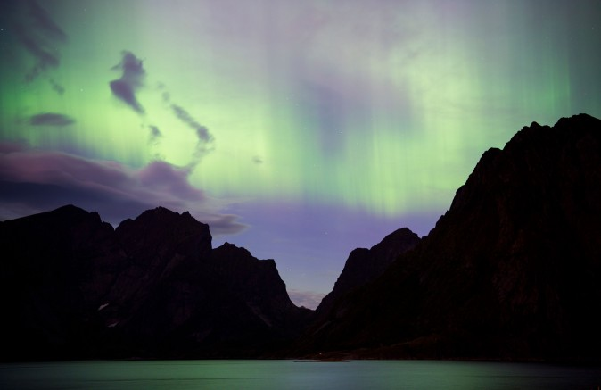 The Northern lights (aurora borealis) illuminate the sky over Reinfjorden in Reine, on Lofoten Islands, Arctic Circle, on Sept. 8. The sun released two powerful solar flares On Sept. 6, which will create brighter auroras extending to as low as Upstate New York for the next few nights. (JONATHAN NACKSTRAND/AFP/Getty Images)