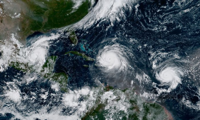 In this NOAA handout image, NOAA's GOES satellite shows Hurricane Katia (L) Hurricane Irma (C) and Hurricane Jose (R) on September 7, 2017 in the Atlantic Ocean. (Photo by NOAA GOES Project via Getty Images)