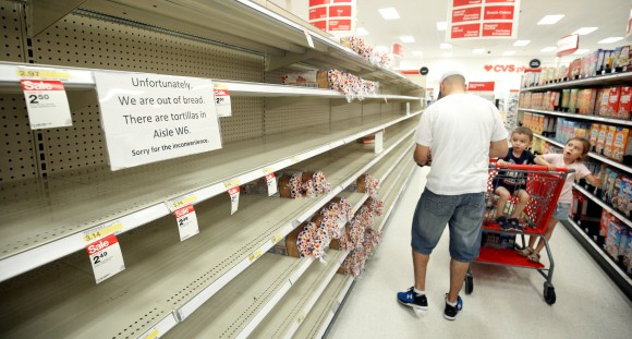 Shoppers encounter empty bread shelves ahead of the arrival of Hurricane Irma at a supermarket in Kissimmee, Florida, U.S. September 8, 2017. (Reuters/Gregg Newton)