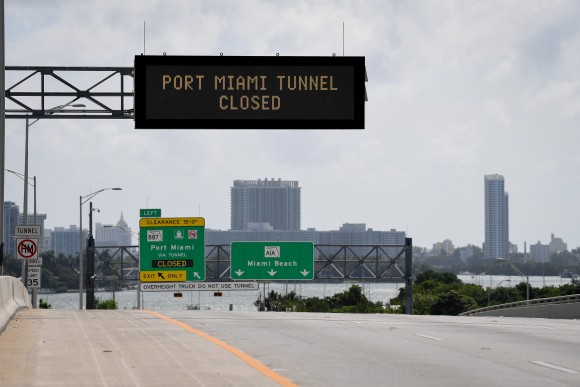 Signs warning of road closures are seen above the road in Miami Beach, Florida, U.S., September 8, 2017. (Reuters/Bryan Woolston)