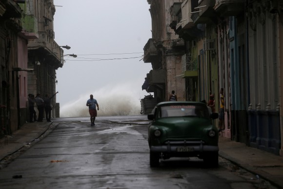 Waves crash on the street as Hurricane Irma turns toward the Florida Keys on Saturday, in Havana, Cuba September 9, 2017. (Reuters/Stringer)