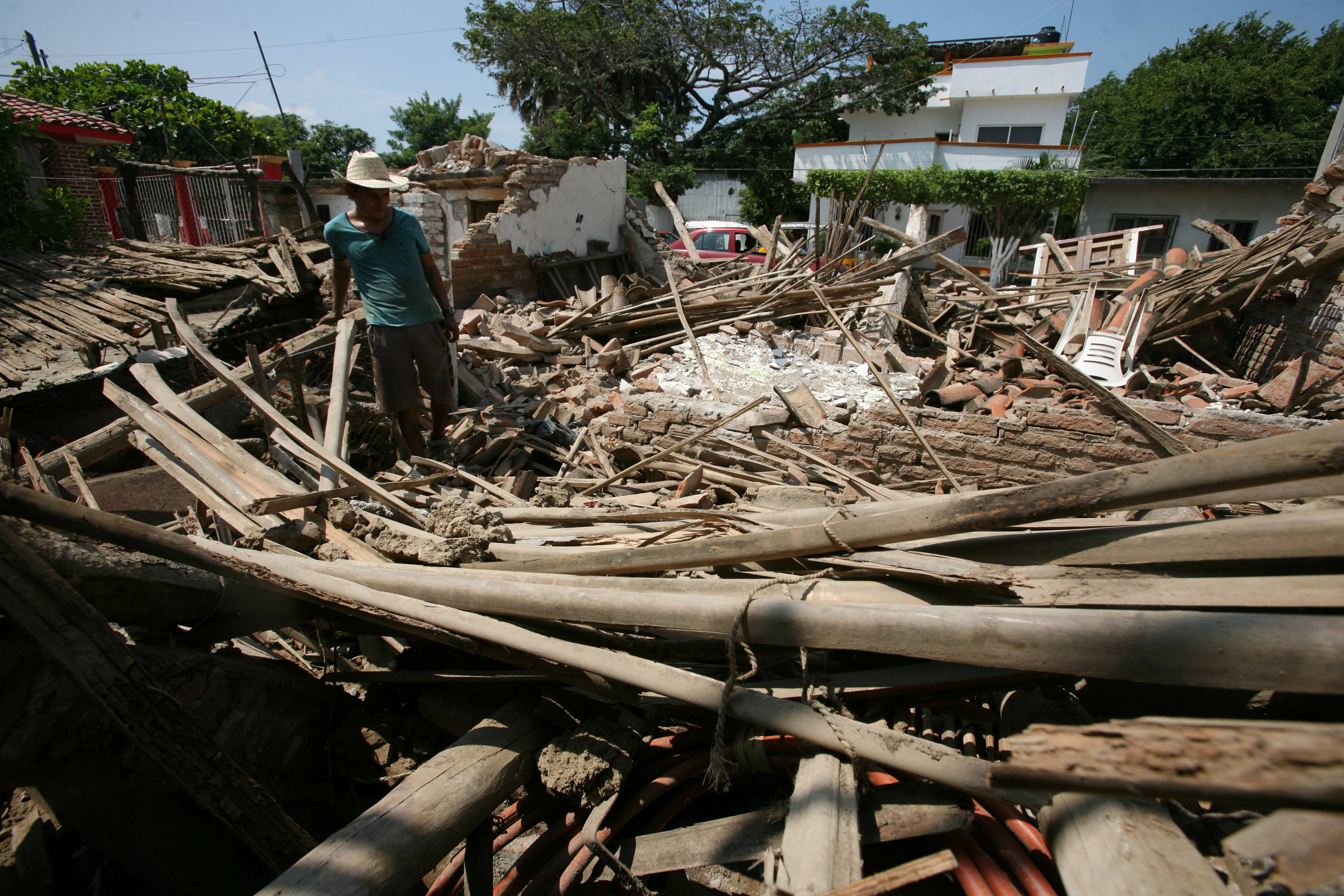 A man stands amidst the remains of a house after an  earthquake struck the southern coast of Mexico in Union Hidalgo, Mexico on Sept. 9, 2017. (REUTERS/Jorge Luis Plata)
