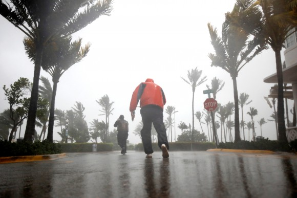 People walk along a street in South Beach as Hurricane Irma arrives at south Florida, in Miami Beach, Florida, U.S., September 10, 2017. (Reuters/Carlos Barria)