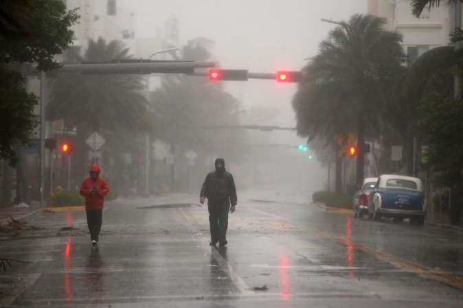 People walk along a street in South Beach as Hurricane Irma arrives at south Florida, in Miami Beach, Florida, U.S., September 10, 2017. REUTERS/Carlos Barria