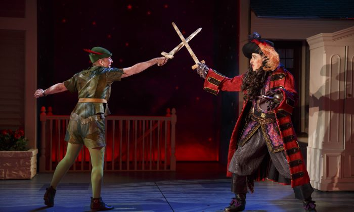"""(L–R) Kathleen Chalfant as Peter Pan and David Chandler as Captain Hook in """"For Peter Pan on her 70th birthday."""" The play mixes fantasy and reality to a charming and touching effect. (Joan Marcus)"""