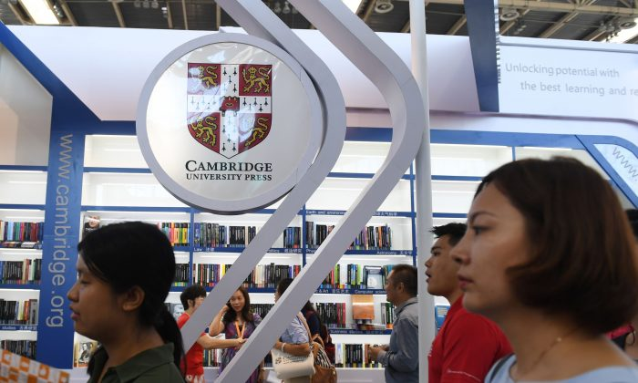 This photo taken on August 23, 2017 shows people at the Cambridge University Press stand at the Beijing International Book Fair in Beijing.  ( GREG BAKER/AFP/Getty Images)