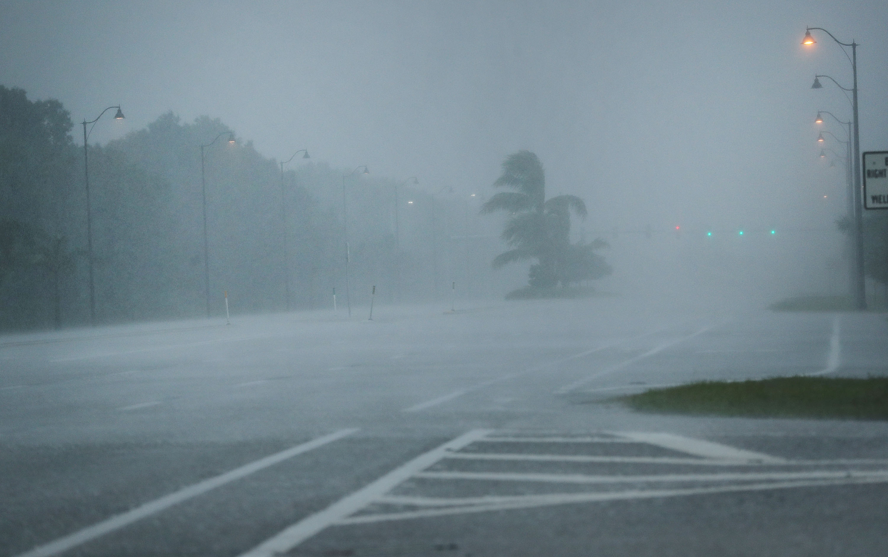 Rain and wind sweep over empty roads as Hurricane Irma arrives into southwest Florida in Bonita Springs, Florida on Sept. 10, 2017. (Photo by Spencer Platt/Getty Images)