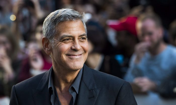 """Director and actor George Clooney arrives on the red carpet for the movie """"Suburbicon"""" during the Toronto International Film Festival in Toronto on Saturday, Sept. 9, 2017. THE CANADIAN PRESS/Nathan Denette"""