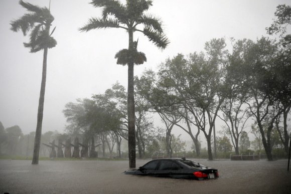 A partially submerged car is seen at a flooded area in Coconut Grove as Hurricane Irma arrives at south Florida, in Miami, Florida, U.S., September 10, 2017. (REUTERS/Carlos Barria)