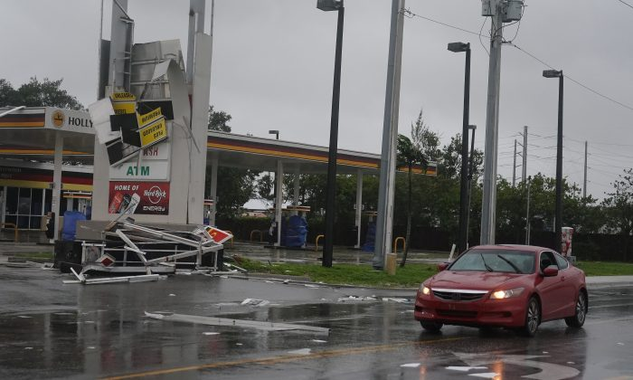 A gas station sign lays destroyed after Hurricane Irma blew though Fort Lauderdale, Florida on Sept. 10, 2017. (REUTERS/Carlo Allegri)