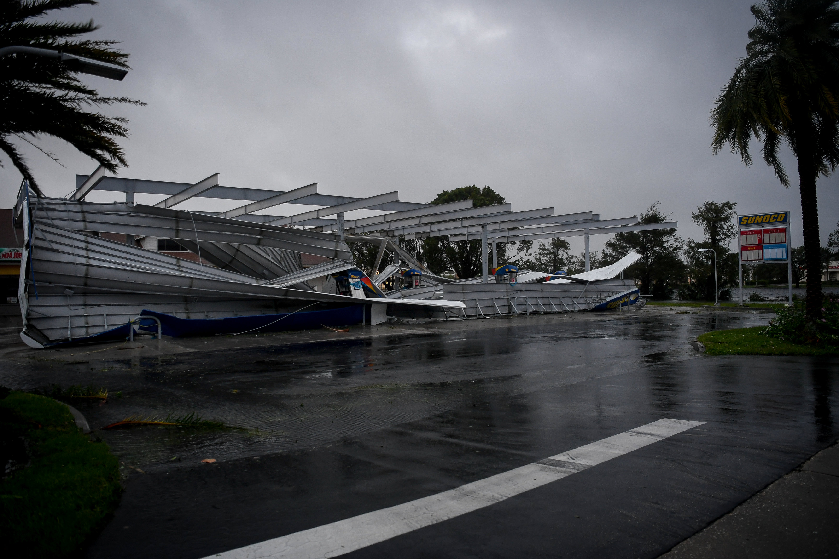 The crumbled canopy of a gas station damaged by Hurricane Irma is seen in Bonita Springs, Florida on Sept. 10, 2017. (REUTERS/Bryan Woolston)