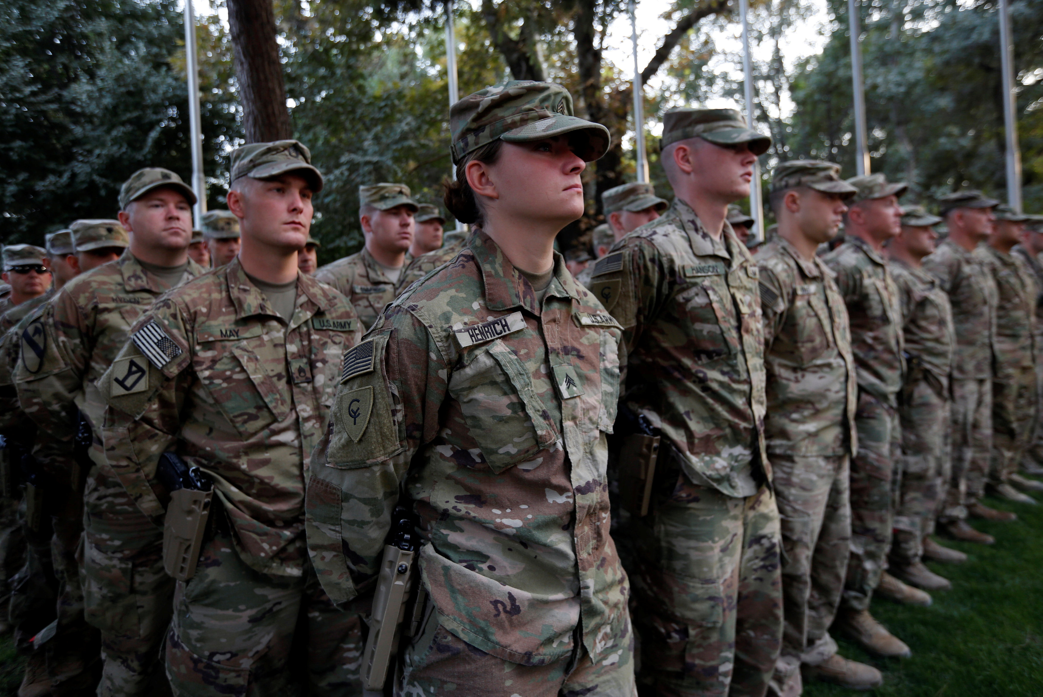 U.S. soldiers take part in a memorial ceremony to commemorate the 16th anniversary of the 9/11 attacks, in Kabul, Afghanistan on Sept. 11, 2017. (REUTERS/Mohammad Ismail)
