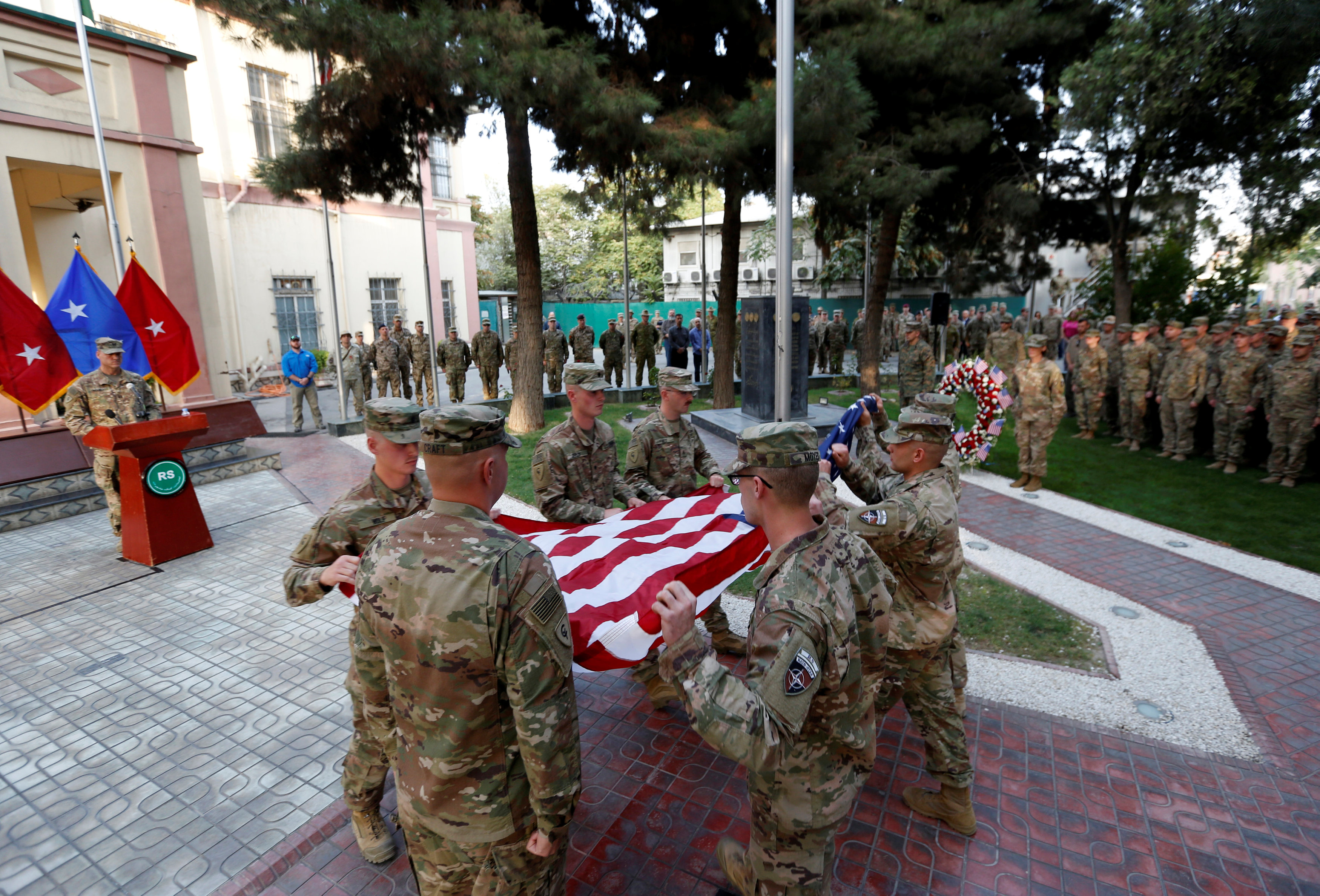U.S. soldiers prepare to raise the American flag during a memorial ceremony to commemorate the 16th anniversary of the 9/11 attacks, in Kabul, Afghanistan on Sept. 11, 2017. (REUTERS/Mohammad Ismail)