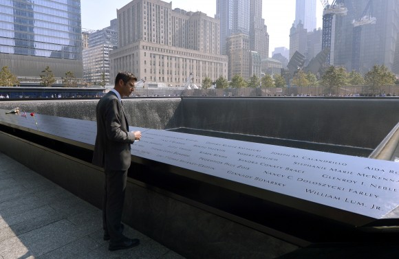 NEW YORK, NY - SEPTEMBER 11: Architect Michael Arad, who designed the 9/11 Memorial, looks over the North Pool during ceremonies for the twelfth anniversary of the terrorist attacks on lower Manhattan at the World Trade Center site on September 11, 2013 in New York City. The nation is commemorating the anniversary of the 2001 attacks which resulted in the deaths of nearly 3,000 people after two hijacked planes crashed into the World Trade Center, one into the Pentagon in Arlington, Virginia and one crash landed in Shanksville, Pennsylvania. Following the attacks in New York, the former location of the Twin Towers has been turned into the National September 11 Memorial & Museum. (Photo by Justin Lane-Pool/Getty Images)