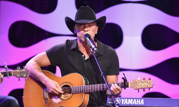 Musician Kenny Chesney performs onstage during the 29th American Cinematheque Award honoring Reese Witherspoon at the Hyatt Regency Century Plaza on October 30, 2015 in Los Angeles, California.  (Kevin Winter/Getty Images)