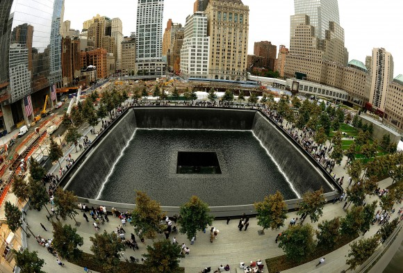 Families line up against the wall of the South Memorial pool during tenth anniversary ceremonies at the site of the World Trade Center September 11, 2011, in New York. (Timothy A. Clary/AFP/Getty Images)