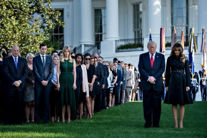 From left National Economic Council Director Gary Cohn, Senior Advisor Jared Kushner, Ivanka Trump, US President Donald Trump and US first lady Melania Trump participate in a moment of silence on the South Lawn of the White House during a memorial service for the 9/11 terrorist attacks September 11, 2017 in Washington, DC. / AFP PHOTO / Brendan Smialowski (Photo credit should read BRENDAN SMIALOWSKI/AFP/Getty Images)