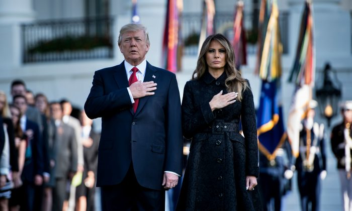 President Donald Trump and First Lady Melania Trump observe a moment of silence on Sept. 11 at the White House in Washington, during an event to commemorate victims of the terrorist attacks on Sept. 11, 2001. (Brendan Smialowski/AFP/Getty Images)
