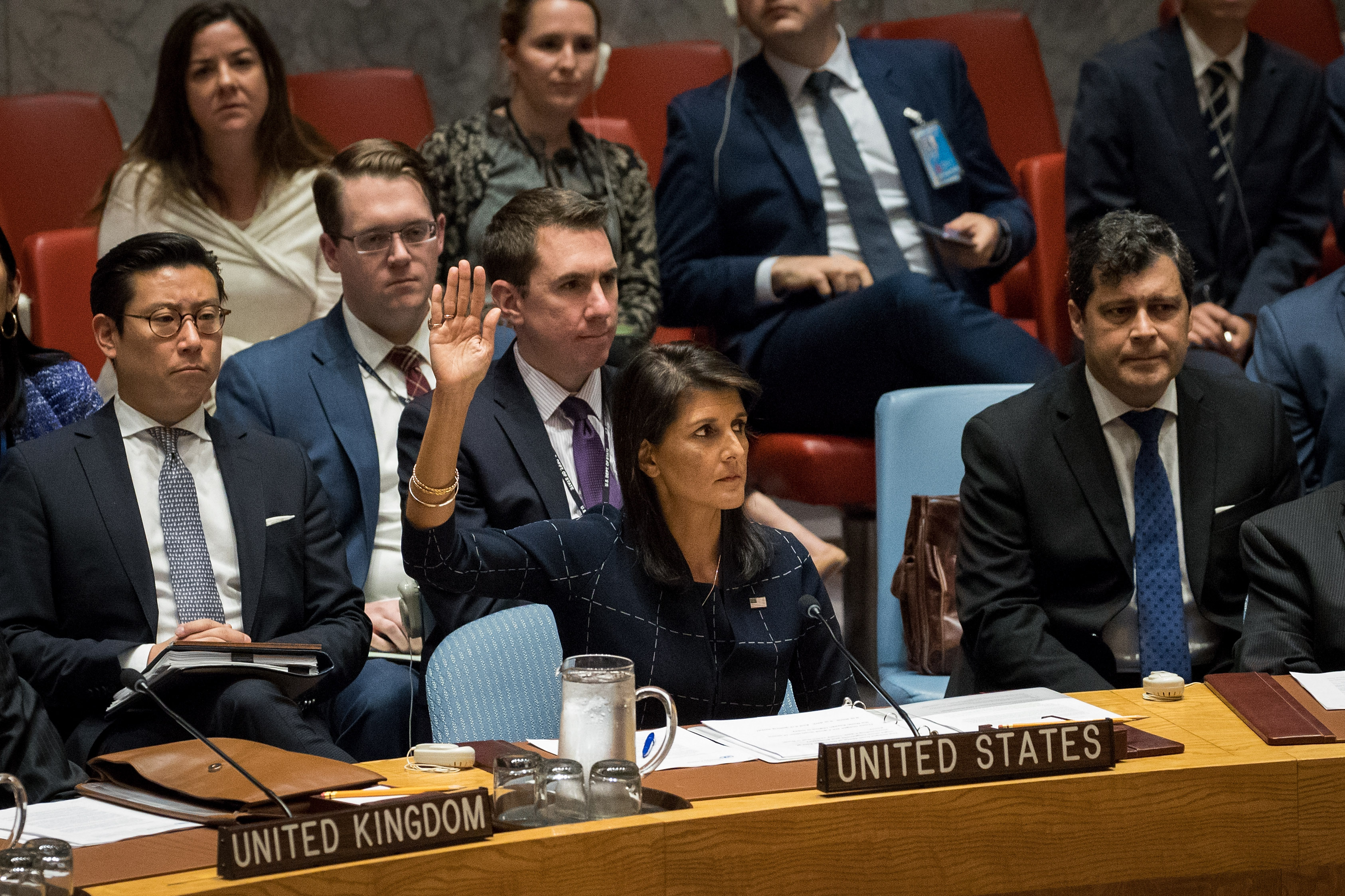 Nikki Haley, United States ambassador to the United Nations, raises her hand as she votes yes to levy new sanctions on North Korea designed to curb their nuclear ambitions during a meeting of the United Nations Security Council concerning North Korea at UN headquarters in New York City on Sept. 11, 2017. (Photo by Drew Angerer/Getty Images)