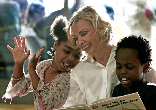 Kindergarden school teacher Janet Thorne who teaches at Northwestern Elementary in nearby Zachary, Louisiana, reads with Hurricane Katrina victims Derrineisha (L), 9, and brother Derrick Early, 8, inside the Riverside Centroplex Red Cross shelter in Baton Rouge, Louisiana on Sept. 3,  2005. (Paul J. Richards/AFP/Getty Images)