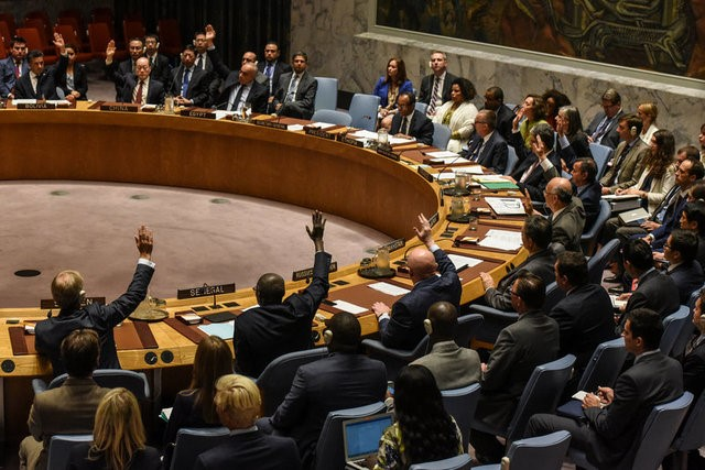 Ambassadors to the UN vote during a United Nations Security Council meeting on North Korea in New York City on Sept. 11, 2017. (REUTERS/Stephanie Keith)