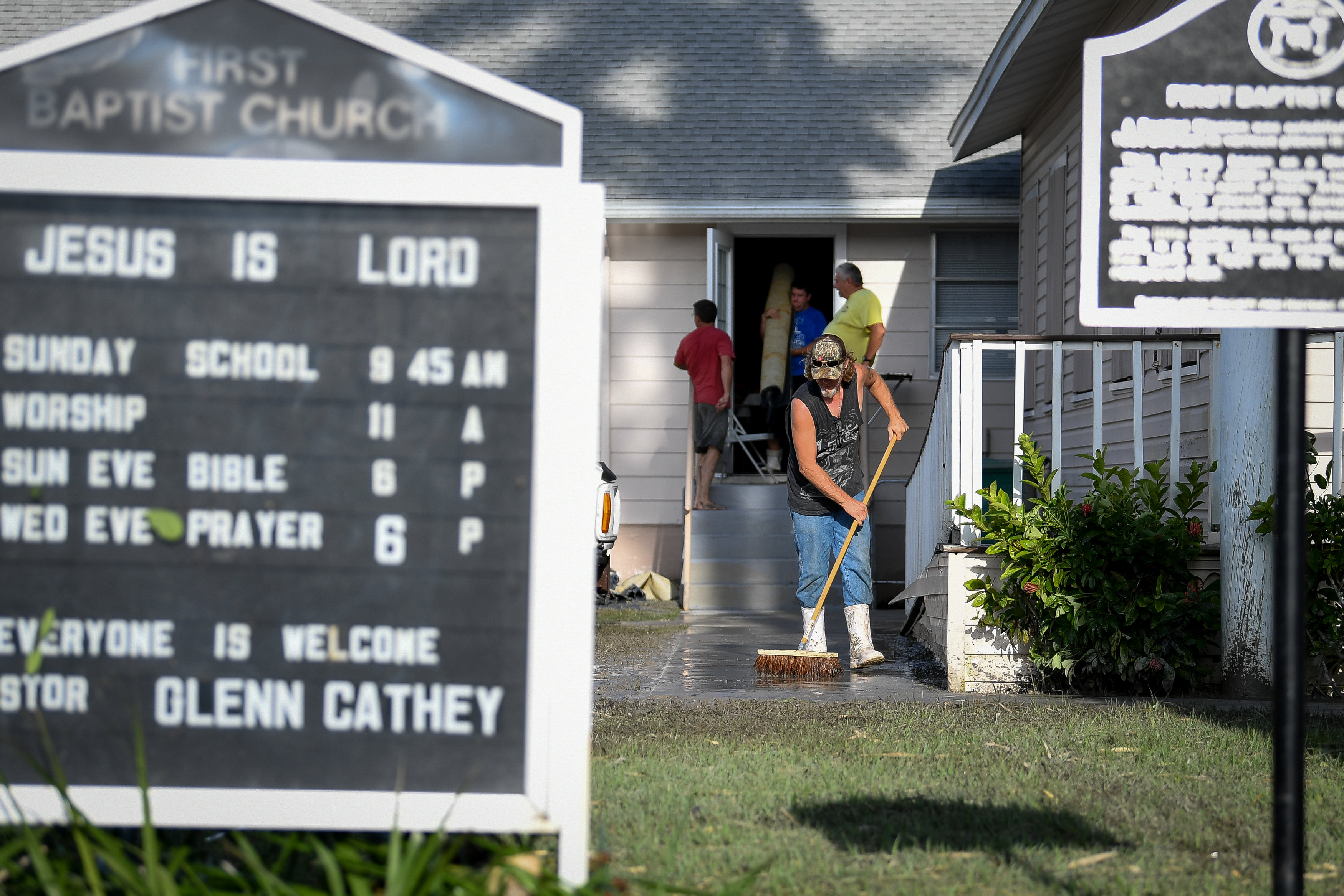 Residents clean up after Hurricane Irma heavily damaged the First Baptist Church in Everglades City, Florida on Sept. 11, 2017. (REUTERS/Bryan Woolston)