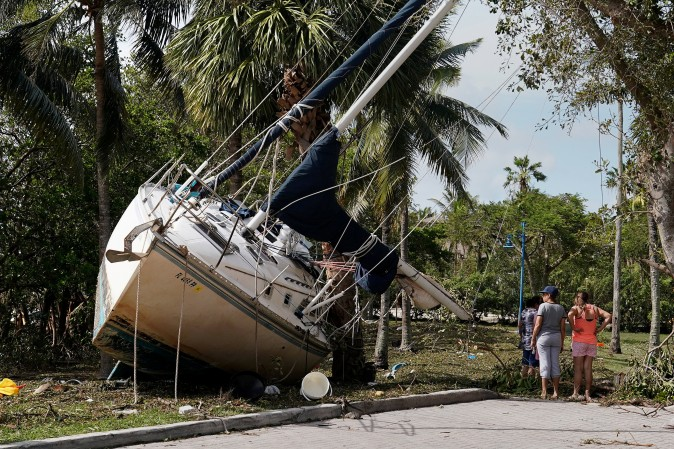 Wrecked boats that have come ashore are pictured in Coconut Grove following Hurricane Irma in Miami, Florida on Sept. 11, 2017. (Reuters/Carlo Allegri)