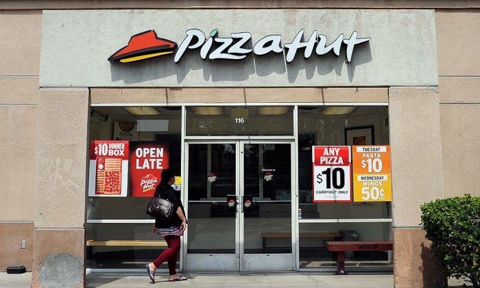 A customer walks in to a Pizza Hut restaurant.  (Kevork Djansezian/Getty Images)