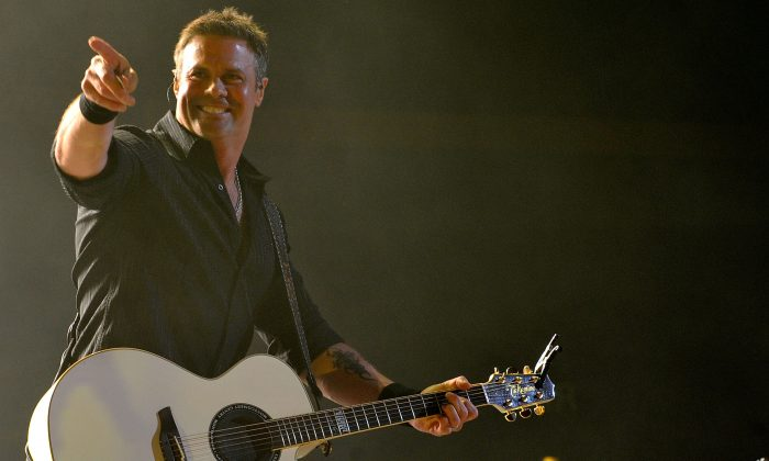 Troy Gentry of Montgomery Gentry performs during Keith Urban's Fourth annual We're All For The Hall benefit concert at Bridgestone Arena on April 16, 2013 in Nashville, Tennessee.  (Frederick Breedon IV/Getty Images for the Country Music Hall of Fame and Museum)