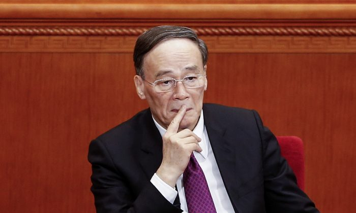 Former anti-corruption czar Wang Qishan at the opening session of the Chinese People's Political Consultative Conference in Beijing on March 3, 2016. (Lintao Zhang/Getty Images)
