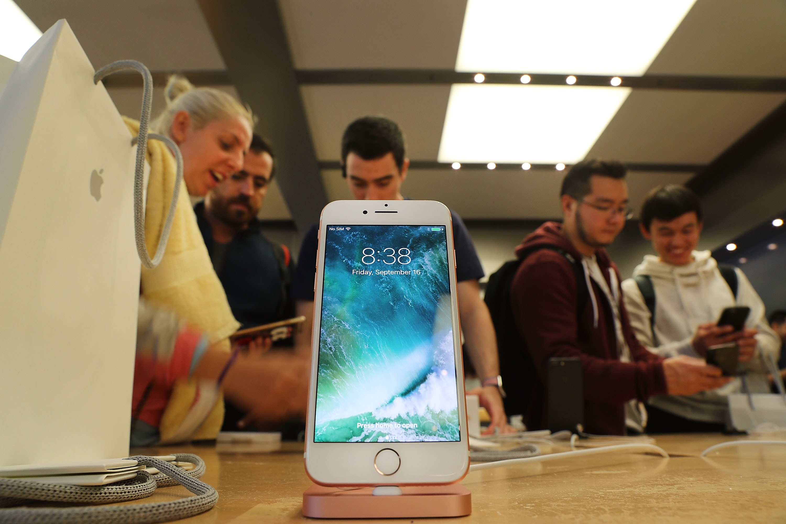 The new iPhone 7 is displayed on a table at an Apple store in Manhattan in New York City on Sept. 16, 2016. (Photo by Spencer Platt/Getty Images)
