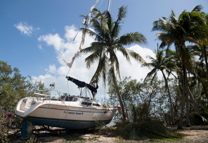 A boat sits onshore in a park after being beached by storm surge from Hurricane Irma in Coconut Grove, Fla., on Sept. 11. (SAUL LOEB/AFP/Getty Images)