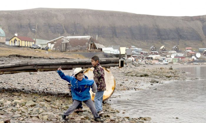 Children skip stones in Arctic Bay, Nunavut, in this file photo. Although tuberculosis is almost unheard of in the south, it is present in many northern reserves and in 17 out of 25 Nunavut communities. (The Canadian Press/Adrian Wyld)