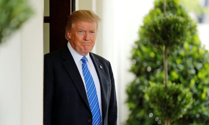 President Donald Trump waits to greet Malaysia's Prime Minister Najib Razak at the White House in Washington on Sept. 12, 2017.  (REUTERS/Jonathan Ernst)